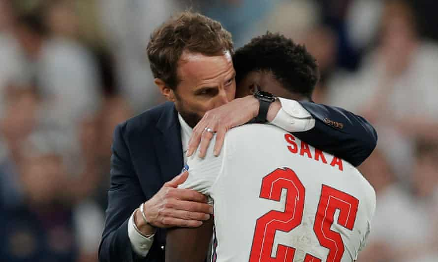 Gareth Southgate with Bukayo Saka after the player's missed penalty in the Euro 2020 final.