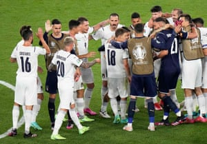 Italy's players celebrate their victory at the end of the game.