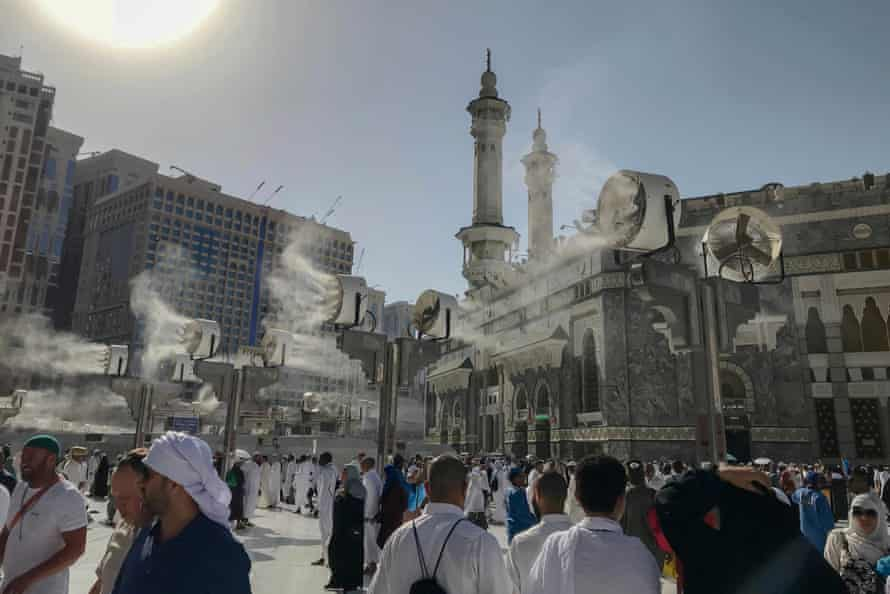 Fans spray water on Muslim pilgrims around the Grand Mosque in the run up to the annual Hajj pilgrimage in Mecca, Saudi Arabia.