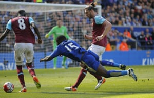 Carroll brings down Schlupp for the penalty.