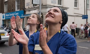 Nurses participate in the weekly applause for key workers outside Chelsea and Westminster hospital in London.