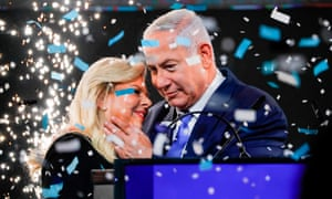 Benjamin Netanyahu with his wife Sara during his appearance before supporters at his Likud party headquarters in Tel Aviv on election night
