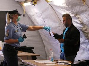 Opatovac, Croatia: Police register refugees at a centre near the Serbian border