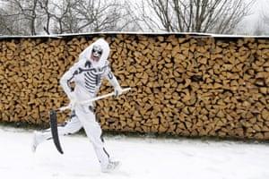 Valašská Polanka, Czech Republic: a reveller dressed as the grim reaper runs during a traditional St Nicholas procession
