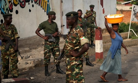 Soldiers in Bujumbura patrol in the capital after the attempted coup. More than 110,000 people have fled Burundi.