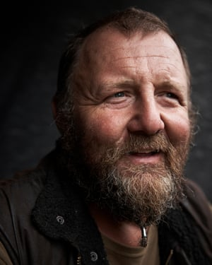 A man with a brown beard