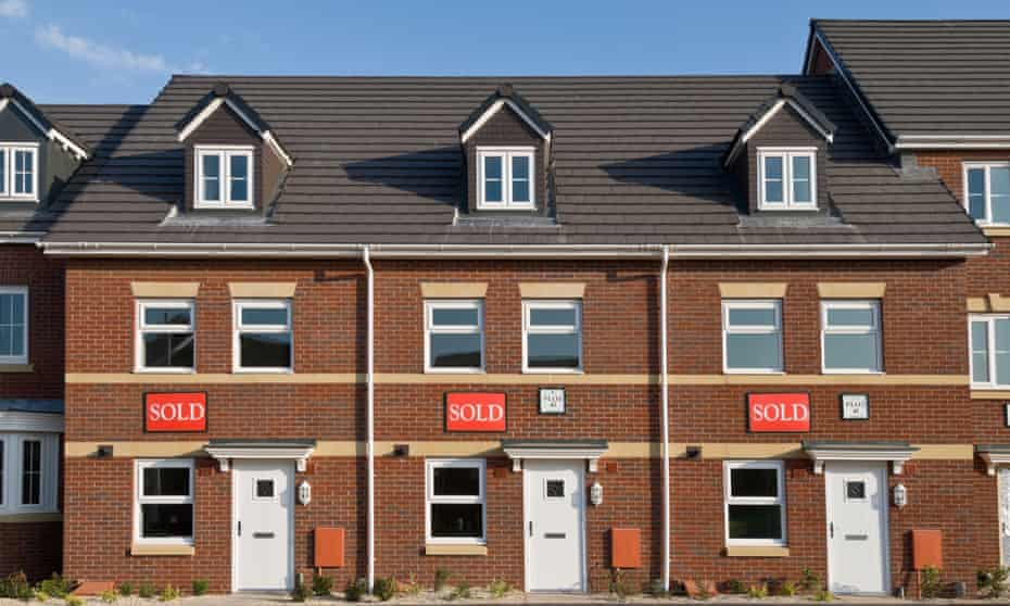 A row of new houses in the UK each with Sold written on them.