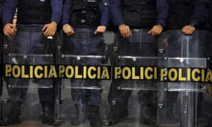 Police officers in Brazil stand guard.