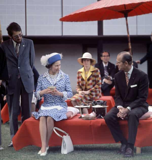 The Queen and Prince Philip taking tea during a state visit to Japan in 1975.