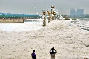A sea of foam gathers at the banks of the Yamuna river in Noida, India