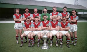 Jimmy McIlroy, front row, second from left, with Burnley's 1959-60 First Division championship team. Jimmy Adamson, the captain, is seated at centre.