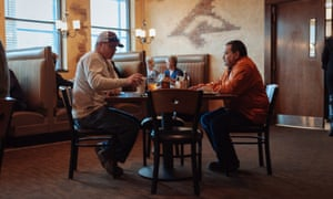 Oil workers relax in the 'Outlaws' Bar and Grill, in downtown Watford City, North Dakota.