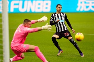 Newcastle United's Miguel Almiron sweeps the ball past Sam Johnstone.