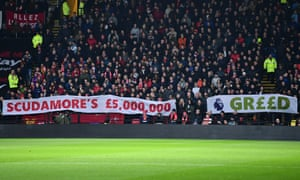 Fans in the Liverpool away section let Richard Scudamore and the Premier League know how they feel about the retiring chief executive's £5m retirement bonus, paid for by the clubs.