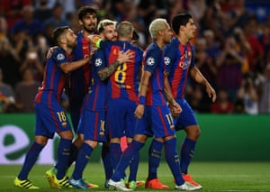 Messi is congratulated by his team-mates after scoring his hat-trick and Barca's fifth.