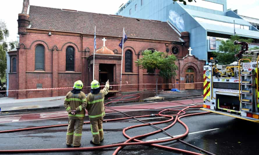 Firefighters survey the scene of a fire at the Annunciation of Our Lady Greek Orthodox Church in Melbourne.