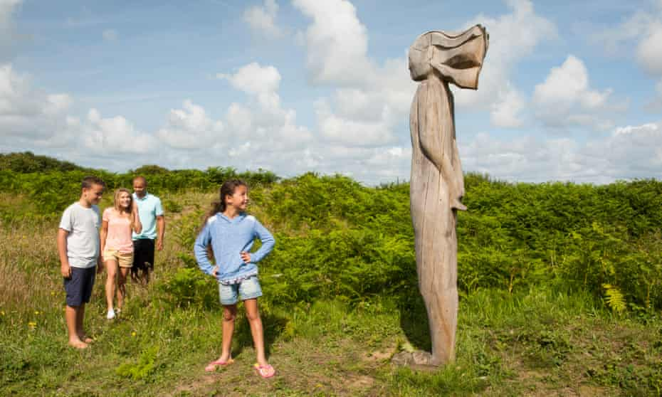 A family group enjoys a nature trail at the Kenfig reserve.