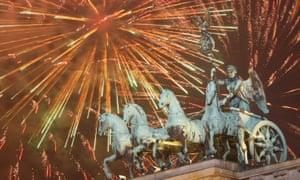 Fireworks explode over the Quadriga sculpture on the Brandenburg gate in celebration of the new year in Berlin.