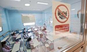 Students attend class at a school in Kuwait City after schools reopened for on-campus learning for the first time in months.