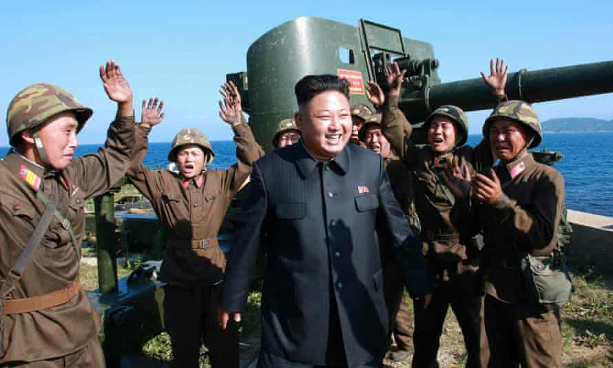 North Korean leader Kim Jong-un is surrounded by cheering soldiers as he is touring a frontline military detachment.