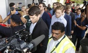 James Paver, centre left, Nick Kelly, centre with glasses, and Thomas Whitworth, centre right, were among the men arrested after stripping to underwear featuring the Malaysian flag
