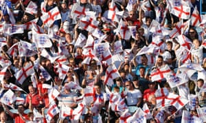 England supporters wave flags at a football match.
