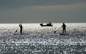 Paddle boarders at Cullercoats Bay