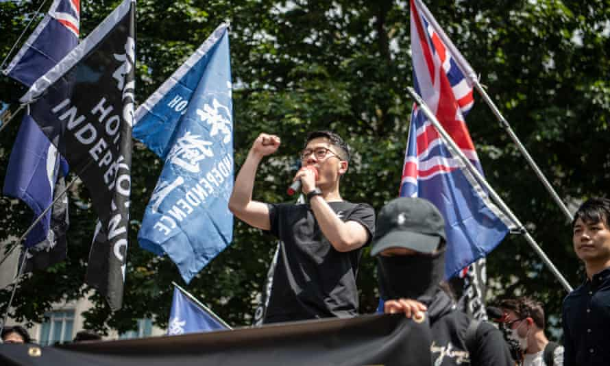 Former Hong Kong lawmaker Nathan Law speaks at a rally for Hong Kong democracy at Marble Arch on 12 June 2021.