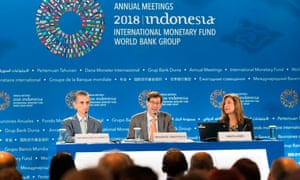 The IMF's Maurice Obstfeld (C) with deputy director Gian Maria Milesi-Ferretti and communications officer Wafa Amr (R) at the conference in Bali.