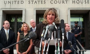 Linda Tripp meets with reporters outside federal court in Washington on 29 July 1998.