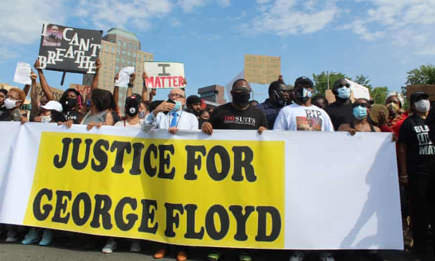 Protesters and mourners march with Terrance Floyd, George Floyd's brother, across Brooklyn Bridge, New York, on 4 June 2020.