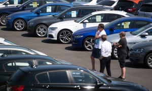 People view cars on a forecourt in Norwich. Car showrooms reopened in England this week as coronavirus lockdown measures were eased.