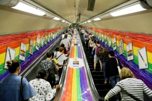 A tube station is adorned with rainbows for Pride