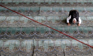An Iranian worshipper prays.