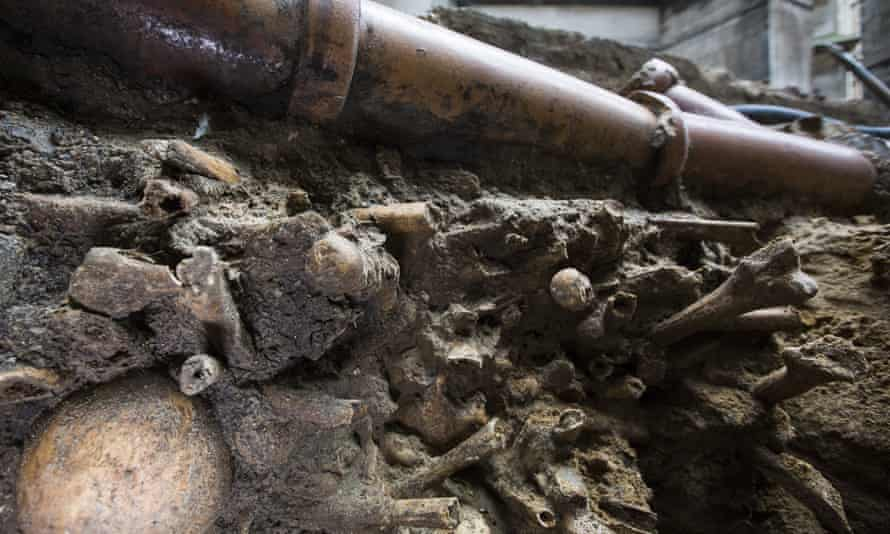 A Victorian pipe can be seen supported by a collection of bones that were found among the stepped footings of Westminster Abbey's south transept.