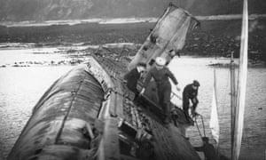 Naval visitors on a listing UB-112.