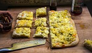 A piece of magic: pizza al taglio as served in Rome.