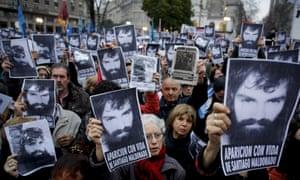 Demonstrators hold photos of Santiago Maldonado in the Plaza de Mayo in Buenos Aires. The Maldonado case has overshadowed the congressional election.