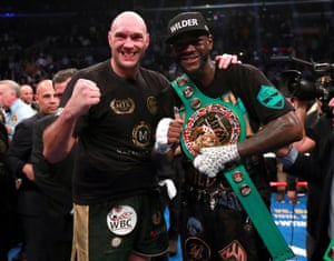 Fury and Wilder pose after the fight is declared a draw by split decision.