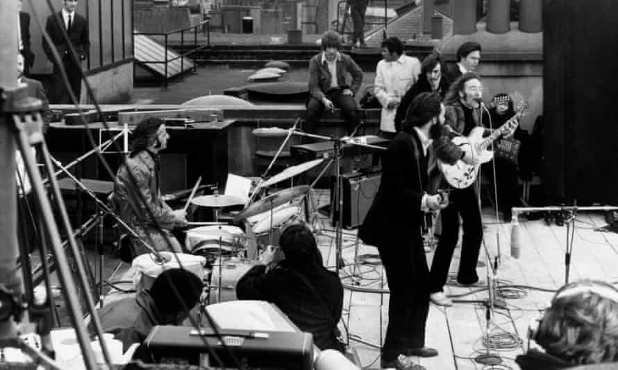 The Beatles performing their last public concert on the rooftop of the Apple Organisation building for the documentary, Let It Be, 30 January 1969.