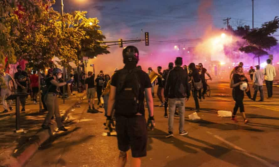 The scene in Minneapolis on Wednesday night. As they did on Tuesday night, police fired rubber bullets and teargas to try to disperse crowds.