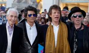 """Members of the Rolling Stones arrive for the """"Exhibitionism"""" opening night gala at the Saatchi Gallery in London"""