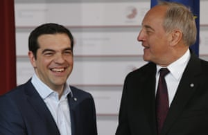 Greek Prime Minister Alexis Tsipras, left, is greeted by Latvian President Andris Berzins as he arrives for a formal dinner at the Eastern Partnership summit in Riga, on Thursday, May 21, 2015. EU leaders on Thursday will seek new ways to bolster ties with six post-communist nations in Eastern Europe, a year and a half after a previous summit of the Eastern Partnership ended with a fateful standoff over Ukraine. (AP Photo/Mindaugas Kulbis)