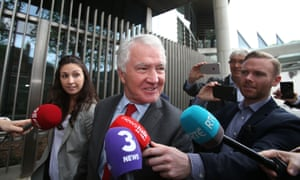Former Anglo Irish Bank chair Seán Fitzpatrick leaves the Dublin circuit criminal court after a judge directed jurors to find him not guilty of fraud.