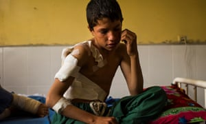 Bilal, 12, recovers in a Jalalabad hospital bed two days after he survived a US drone strike that killed his father.