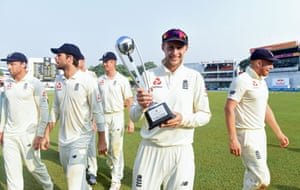 England captain Joe Root poses with the winner's trophy after defeating Sri Lanka by 42 runs.