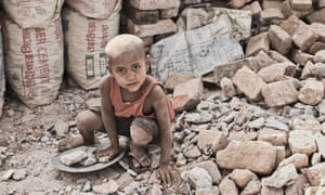 street boy collects stones in Dhaka, Bangladesh.