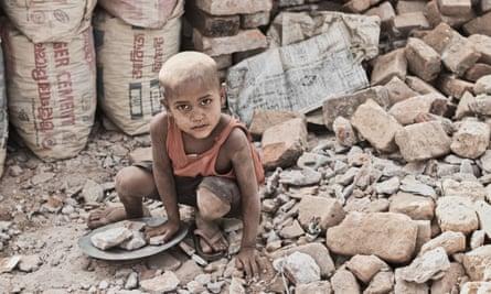street boy collects stones in Dhaka, Bangladesh.