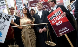 Thousands of lawyers staging a walkout in 2014 against cuts to legal aid.