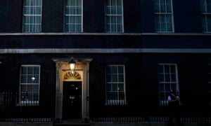 A light shines outside Number 10 Downing Street, as votes are counted for the EU referendum.